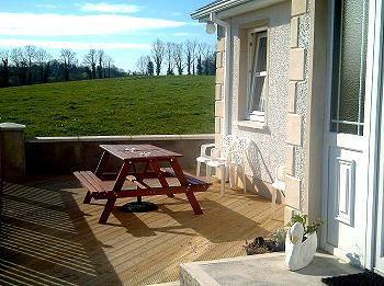 Outside wooden decking with picnic table